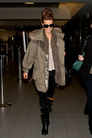 Kate stayed warm at the airport in a fur trimmed bomber jacket and knee-high boots.
