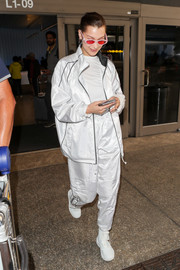 Bella Hadid matched her jacket with a pair of white track pants.