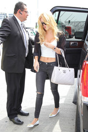 Bella Thorne donned a pair of ripped jeans by AllSaints for a bit of edge to her look.