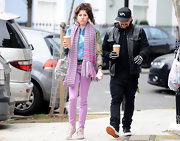 Eliza Doolittle kept her street style on trend with a pair of powder pink skinny jeans and a matching knit scarf.