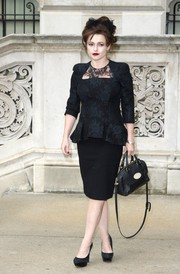 Helena Bonham Carter sealed off her classy all-black look with a leather cross-body tote.