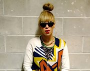 A high top knot kept Queen Bey's look dramatic and cool.