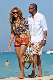 Beyonce showed off her on-trend leopard print bag while arriving at Club 55 with husband Jay-Z.