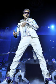 Justin sets the stage on fire with his dance moves and stylin' white pants.