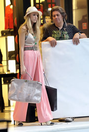 Blake Lively paired her soft pink trousers with a straw fedora hat.