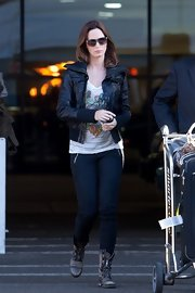 "Emily wore a pair of ""Agnes"" modern moto-zip skinny jeans for her trip to LAX."