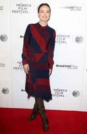 Olivia Wilde chose a pair of slouchy brown boots to team with her dress.