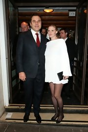 Lara Stone opted for an all-white cocktail dress while attending 'The Book of Mormon.'