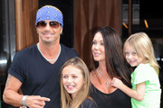 Bret Michaels steps out of his hotel with his family, longtime girlfriend Kristi Lynn Gibson and their two daugthers, Raine Elizabeth (b. May 2000) and Jorja Bleu (b. Ma 2005), as they head out to film their reality show,