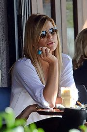 Vogue Williams brightened up her white button-down with an oversize turquoise ring that emphasized her slender fingers.