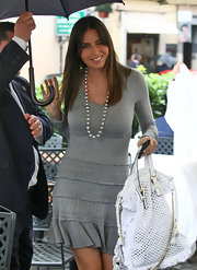 Elisabetta paired her grey long sleeve dress with a silver beaded necklace.