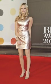 Laura Whitmore kept her footwear classic with nude pointy pumps.