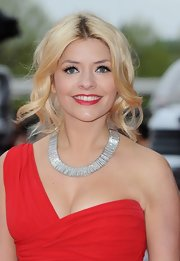 Holly Willoughbey chose a pinned updo to pull back her soft blonde curls at the BAFTA TV Awards.