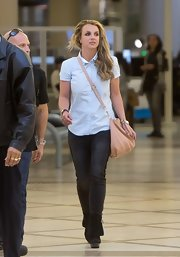 Britney Spears stuck to her signature casual look when she sported this short-sleeved button down.