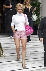 Britney Spears wears pink plaid shorts with her white turtleneck while leaving her hotel.