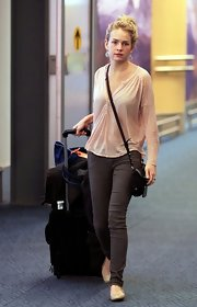 Britt Robertson was dressed for comfort in gray skinnies and a Henley at the airport.