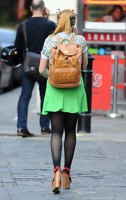 Paloma Faith rocked the '90s-style leather backpack while out and about in London.