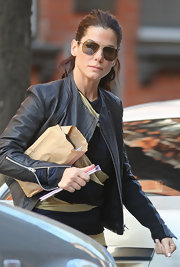 Out and about in LA, Sandra showed off these sporty aviator style sunglasses. The Oscar nominated actress maintains her style on and off the red carpet.