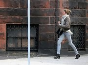 Gisele Bundchen hit the streets in an olive bomber jacket and sleek skinny jeans.