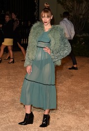 Jaime King added more drama with a fuzzy blue jacket, also by Burberry Prorsum.