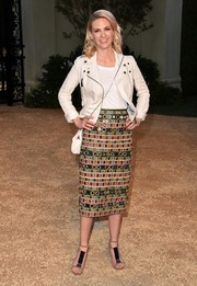 January Jones softened up the edge with an intricately embroidered pencil skirt, also by Burberry.