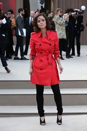 Alice Braga showed off some color with a brigh red trench coat at the Burberry Prorsum runway show.