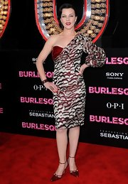 Debi wore a one-shoulder Carolina Herrera design for the 'Burlesque' premiere. The red print gown was a unique, but appreciated, choice for the red carpet.