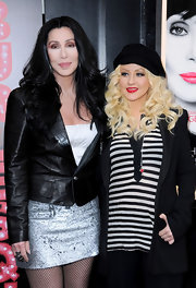 Cher was sexy-edgy at the 'Burlesque' photocall in a black leather jacket layered over a mini dress.