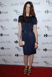Paz Vega added shine to her sophisticated navy dress with gold Malika sandals. The knockout platforms feature metal spike heels.