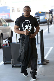 Reggie shows off his muscles with this black and white graphic tee.  We're loving the matching black rimmed glasses!