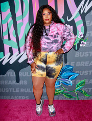 Lizzo completed her fun look with a pair of tie-dye bike shorts.