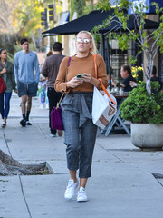 Busy Philipps took a stroll in LA wearing a simple brown crewneck sweater.