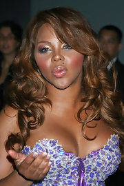 Lil Kim wore her bouncy curls down at the MAC Cosmetics' event.