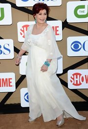 Sharon Osbourne attended the CW & Showtime 2013 TCA party wearing a loose chiffon gown.
