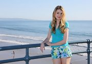 CC Mason paired a baby blue t-shirt with tropical print shorts for a photo shoot in Santa Monica.