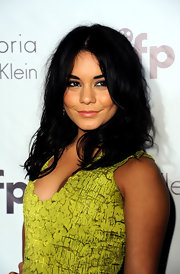 Vanessa Hudgens styled her shoulder length hair in soft center part waves for the Women in Independent Film party.