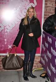 Camille Grammer signed autographs in a black wool coat with brown fur trim.