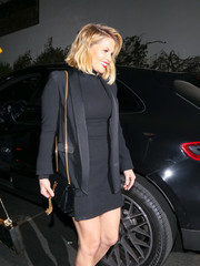 Candace Cameron Bure headed out in West Hollywood carrying a chic tasseled bag by Yves Saint Laurent.