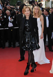 Isabelle Huppert completed her fab ensemble with a pair of beribboned black pumps.