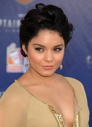Vanessa Hudgens donned a tan tunic for the 'Captain America' premiere. She finished off the look with full and flirty lashes.