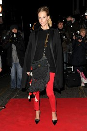 Poppy Delevingne styled her outfit with a pair of silver-accented black velvet pumps.