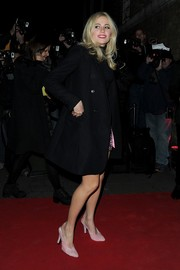 Pixie Lott arrived for the YSL party wearing a classic black wool coat.