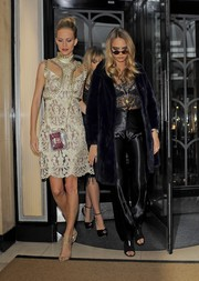 Poppy Delevingne radiated in a gold lace cutout dress by Erdem as she made her way to the British Fashion Council party.