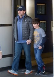 Steve Carell bundled up in this gray puffa jacket while traveling with his family.