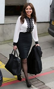 Carol Vorderman opted for a white blouse with black lace to keep her look modern and sophisticated.