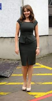 Carol Vorderman chose this fitted black dress with a structured peplum top and fitted pencil skirt for her look while out at the London Studios.