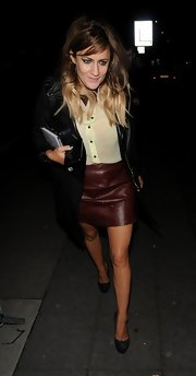 Caroline's dark red leather skirt looked awesome with her light blouse.