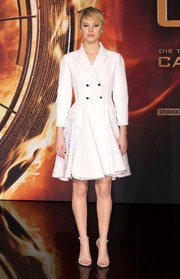 Jennifer Lawrence made a very classy choice with this double-breasted white Christian Dior coat when she attended the 'Catching Fire' Berlin premiere.