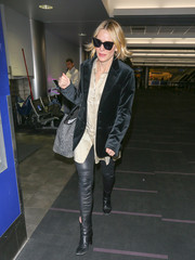 A pair of black leather boots continued the edgy vibe.