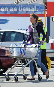Kate Middleton was shopping in style in North Wales with a purple sweater paired with a plaid scarf.